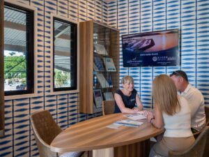 Guest Service Agent with guests at marina office during check in