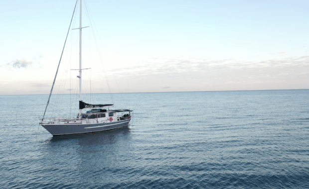 Sailing vessel Major Tom anchored in calm waters